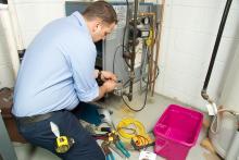 plumber-repairs-furnace.jpg
